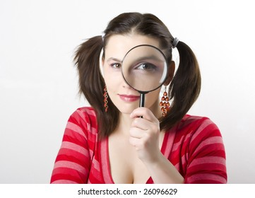 pretty young woman with magnifying