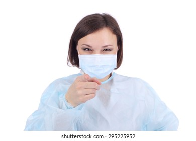 pretty young woman in the medical uniform pointing at something, focus on the hand