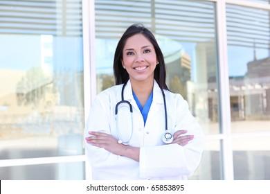 A pretty young woman nurse outside hospital building