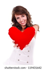 Pretty young woman offering a red heart to us