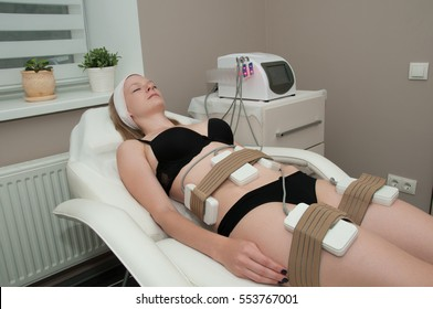 Pretty young woman on laser liposuction in cosmetic cabinet