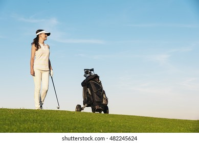 Pretty young woman playing golf. Golf Concept.