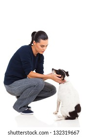 pretty young woman playing with her pet dog on white background