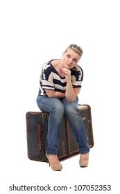 Pretty young woman preparing to travel alone