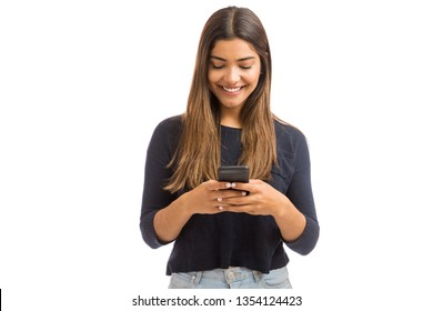 Pretty young woman reaching followers by blogging on smartphone over white background