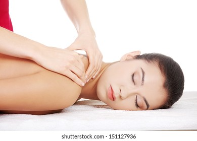 Pretty young woman relaxing heaving massage therapy in spa saloon