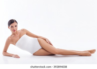 Pretty young woman is relaxing at spa
