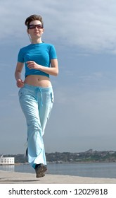 Pretty young woman running outdoor