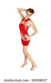 A pretty and young woman from the side in a red short and tight dress standing in high heels for white background with her lovely figure.