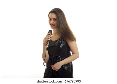 pretty young woman sings a karaoke