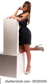 pretty young woman sitting on wooden cubes