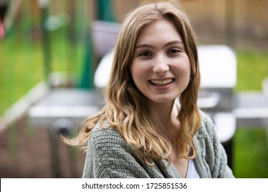 Pretty young woman smiling outside