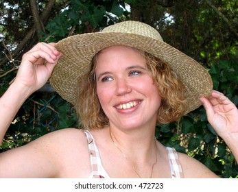 Pretty young woman in straw hat