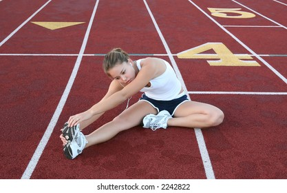 A pretty young woman stretching before jogging