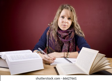 Pretty, young woman studying in a home environment.