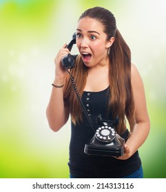 pretty young woman surprised talking on telephone