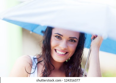 pretty young woman under umbrella in the rain