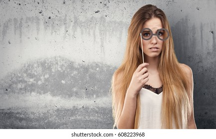 pretty young woman using party glasses
