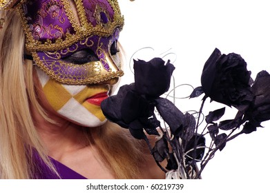 pretty young woman in violet mask sniff black roses, isolated on white, may be use for Venice concept