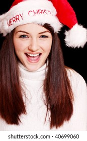 bfe34e04925ca A pretty young woman wearing a santa hat on a black background.