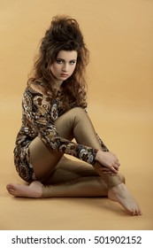 pretty young woman wearing tunic and gold pants