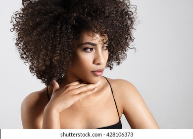pretty young woman wears huge afro hair