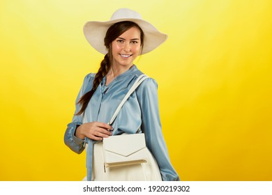 pretty young woman with white hat looking in camara smiling
