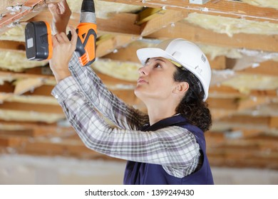 pretty young woman worker with building puncher