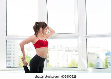 Pretty young woman working out at home