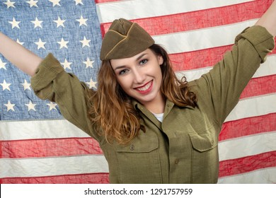 a pretty young woman in wwii  uniform us with an american flag