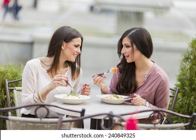 Pretty young women having lunch in the restaurant