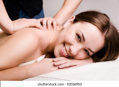 Pretty young women relaxing in the spa salon