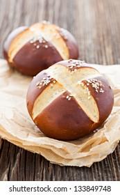 pretzel bun on wooden table