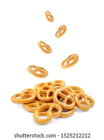 Pretzel with many small cookies scattered and falling from above on a white background. Traditional food for Oktoberfest - salt pretzels appetizer on a white background. German Pretzel (Bretzel), Okto