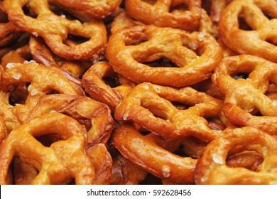 Pretzel shaped bread sticks cracker texture pattern. Salted pretzels