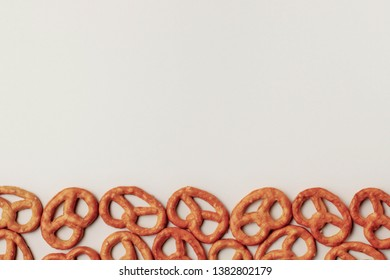 Pretzels on a white background, with a lot of copy space, high contrast, bright natural colors