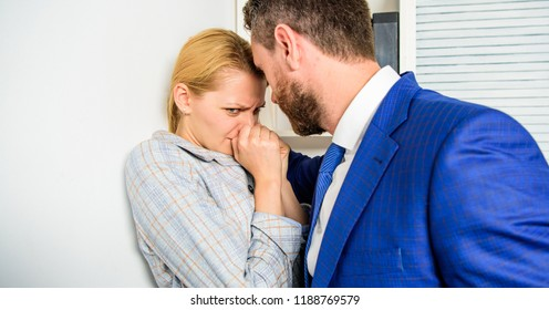 Prevalence of sexual assault and harassment at workplace. Woman worker suffers from sexual assault and harassment. Girl victim office violence concept. Boss unacceptable behavior subordinate employee.