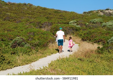PREVELLY, AUSTRALIA - 23 DECEMBER 2016: A father & daughter walk along a path near the beach in Prevelly. Prevelly is a popular beach holiday and tourist destination south of Perth. Editorial