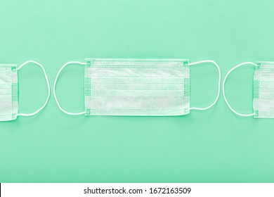 Prevent coronavirus. Medical mask, Medical protective mask isolated on green background. Disposable surgical face mask cover mouth and nose. Healthcare medical Coronavirus quarantine, hygiene concept