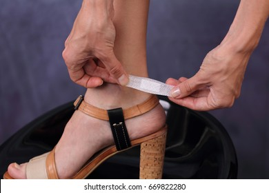 Prevent New Shoes From Giving Blisters. Woman's heel with blister plaster / band-aid on cloe up