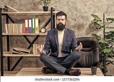 Prevent professional burnout. Man bearded manager formal suit sit lotus pose relaxing. Way to relax. Meditation yoga. Self care. Psychological help. Relaxation techniques. Mental wellbeing and relax.