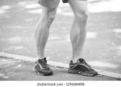 Prevent varicose concept. Legs of male athlete runner jogging park sidewalk. Training cardio in proper sport shoes. Vascular disease varicose veins problems active life. Disease caused by run.