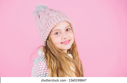 Prevent winter hair damage. Winter hair care tips you should definitely follow. Winter time train yourself to go longer between washes. Child long hair smiling. Girl wear knitted hat pink background.