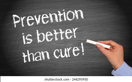 Prevention is better than cure - female hand writing on chalkboard