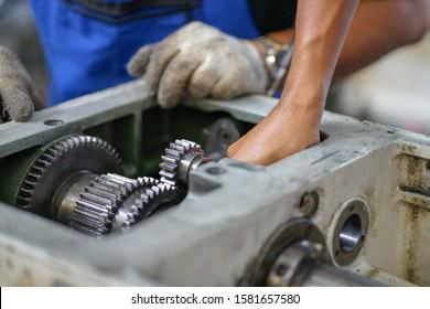 Preventive machine maintenance and retrofit in machine shop.