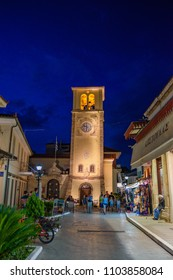 PREVEZA CITY, EPIRUS GREECE - MAY 2018: Night life with tourists and visitors walking along the pedestrian streets of the picturesque city of Preveza, Greece, Europe.