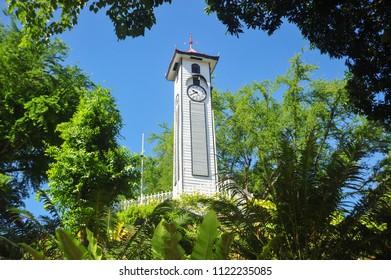 Pre-war Atkinson Clock Tower with green foliage at Kota Kinabalu city, Sabah, Malaysia.