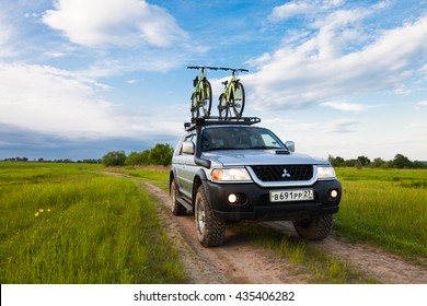 PRIAMURSKY, RUSSIA - JUNE 10, 2016: Mitsubishi Pajero Sport with two bicycles on roof rack