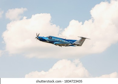 PRIBRAM, CZECH REPUBLIC - 12 August 2020. Pilatus PC-12 NGX, Single-engine turboprop blue airplane. The Pilatus PC-12 NGX torboprop aircraft flies in the blue sky with clouds.