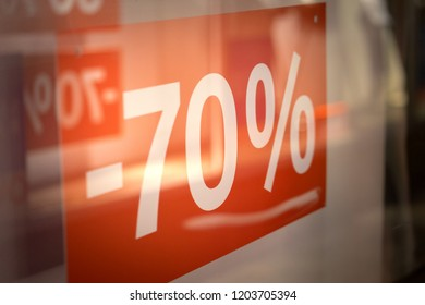 Price discount tag at shopping store during on sale festival, mid-year sale season. Shopping and business concept. Selected focus.